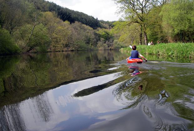 Child kayaking on River Blavet in France